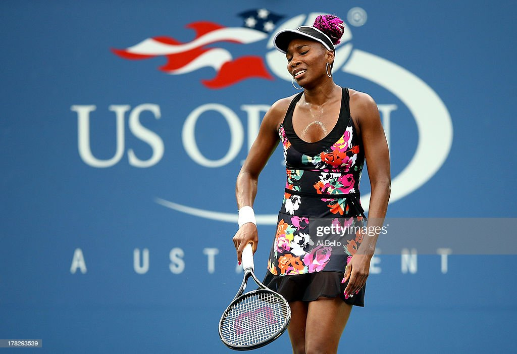 Venus Williams of the United States reacts during her women's singles second round match against Jie Zheng of China on Day Three of the 2013 US Open at USTA Billie Jean King National Tennis Center on August 28, 2013 in the Flushing neighborhood of the Queens borough of New York City.