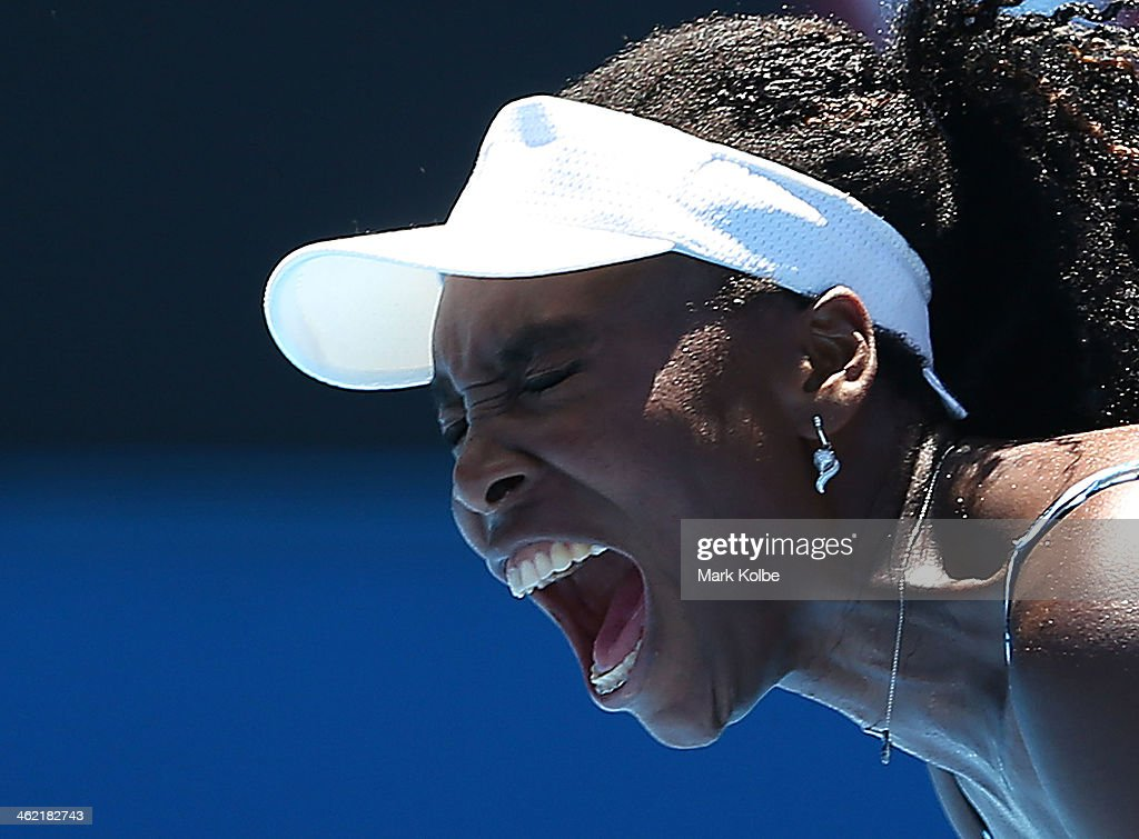 <a gi-track='captionPersonalityLinkClicked' href=/galleries/search?phrase=Venus+Williams&family=editorial&specificpeople=171981 ng-click='$event.stopPropagation()'>Venus Williams</a> of the United States reacts in her first round match against Ekaterina Makarova of Russia during day one of the 2014 Australian Open at Melbourne Park on January 13, 2014 in Melbourne, Australia.