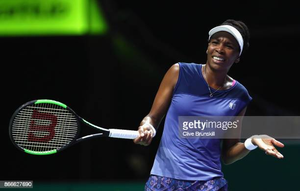 Venus Williams of the United States reacts in her singles match against Garbine Muguruza of Spain during day 5 of the BNP Paribas WTA Finals...