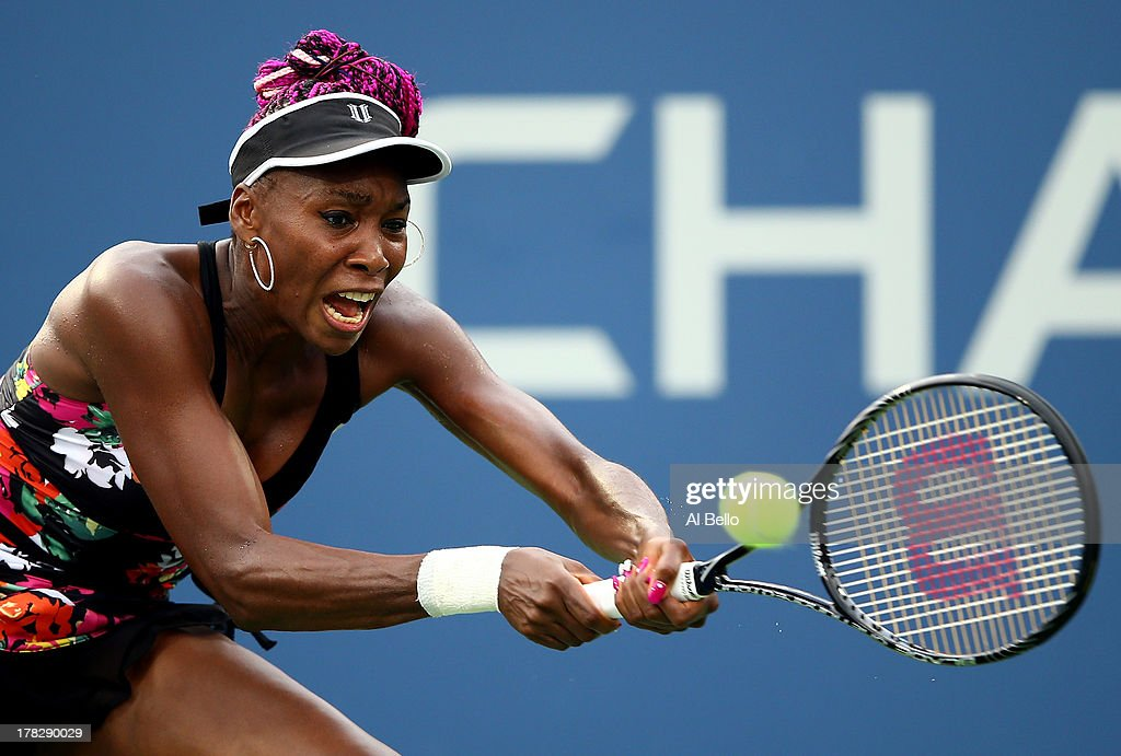 Venus Williams of the United States returns a forehand against Jie Zheng of China during their woman's singles second round match on Day Three of the 2013 US Open at USTA Billie Jean King National Tennis Center on August 28, 2013 in the Flushing neighborhood of the Queens borough of New York City.
