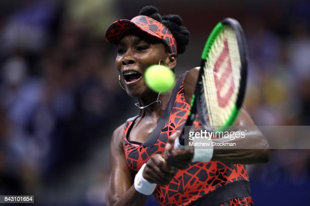 Venus Williams of the United States returns a shot against Petra Kvitova of Czech Republic during her Women's Singles Quarterfinal match on Day Nine...