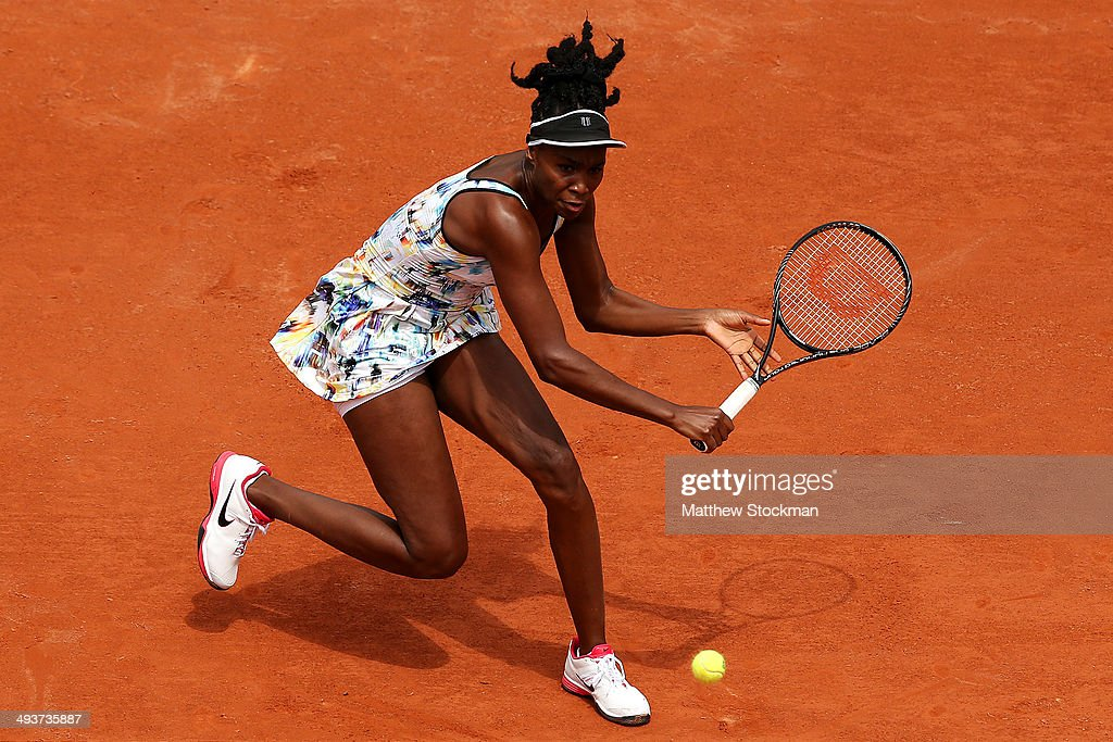 Venus Williams of the United States returns a shot during her women's singles match against Belinda Bencic of Switzerland on day one of the French Open at Roland Garros on May 25, 2014 in Paris, France.