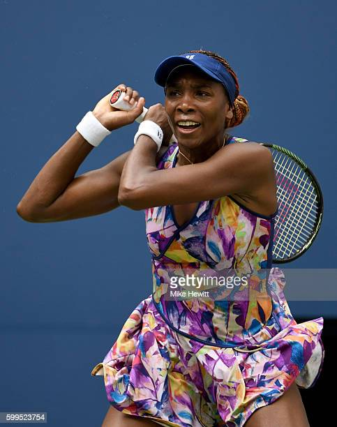 Venus Williams of the United States returns a shot to Karolina Pliskova of the Czech Republic during her fourth round Women's Singles match on Day...
