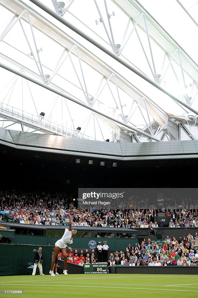 <a gi-track='captionPersonalityLinkClicked' href=/galleries/search?phrase=Venus+Williams&family=editorial&specificpeople=171981 ng-click='$event.stopPropagation()'>Venus Williams</a> of the United States serves during her second round match against Kimiko Date-Krumm of Japan on Day Three of the Wimbledon Lawn Tennis Championships at the All England Lawn Tennis and Croquet Club on June 22, 2011 in London, England.
