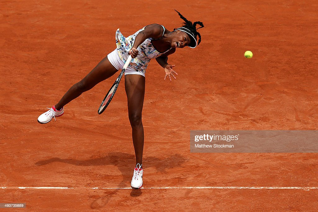 Venus Williams of the United States serves during her women's singles match against Belinda Bencic of Switzerland on day one of the French Open at Roland Garros on May 25, 2014 in Paris, France.