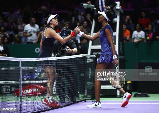 Venus Williams of the United States shakes hands with Garbine Muguruza of Spain after her victory in their singles match during day 5 of the BNP...