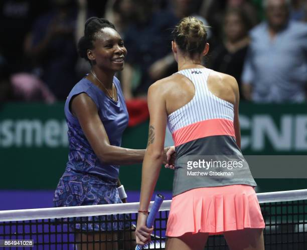 Venus Williams of the United States shakes hands with winner Karolina Pliskova of Czech Republic after their singles match during day 1 of the BNP...