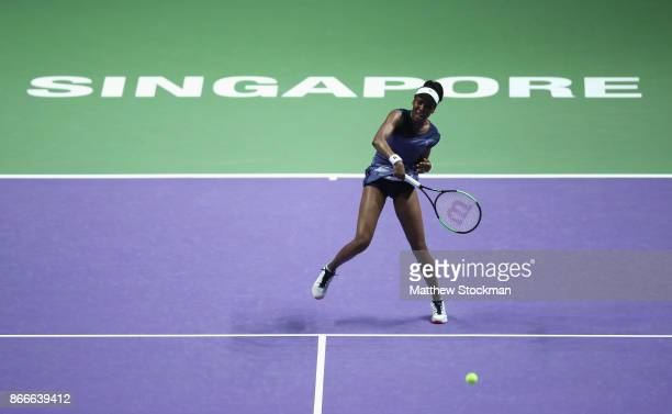 Venus Williams of the United States smashes in her singles match against Garbine Muguruza of Spain during day 5 of the BNP Paribas WTA Finals...