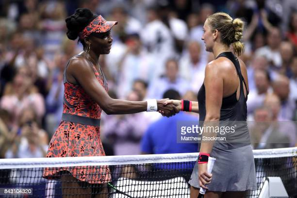 Venus Williams of the United States speaks to Petra Kvitova of Czech Republic after defeating her during their Women's Singles Quarterfinal match on...