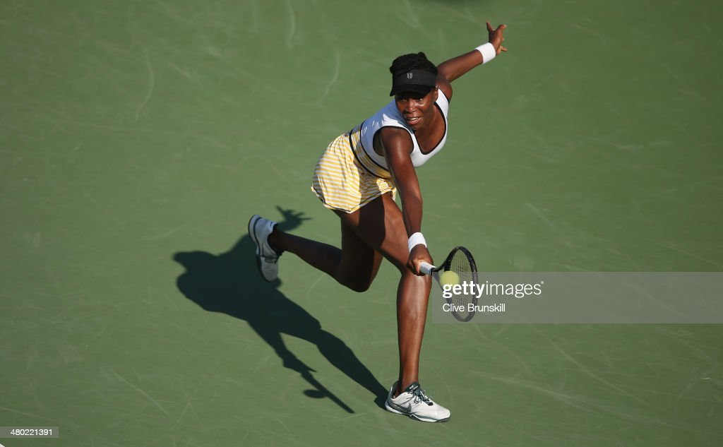 <a gi-track='captionPersonalityLinkClicked' href=/galleries/search?phrase=Venus+Williams&family=editorial&specificpeople=171981 ng-click='$event.stopPropagation()'>Venus Williams</a> of the United States stretches to play a backhand against Casey Dellacqua of Australia during their third round match during day 7 at the Sony Open at Crandon Park Tennis Center on March 23, 2014 in Key Biscayne, Florida.
