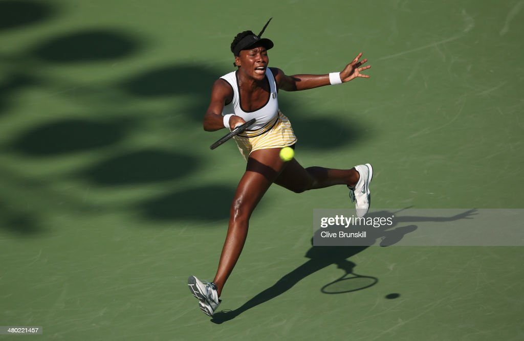 <a gi-track='captionPersonalityLinkClicked' href=/galleries/search?phrase=Venus+Williams&family=editorial&specificpeople=171981 ng-click='$event.stopPropagation()'>Venus Williams</a> of the United States stretches to play a forehand against Casey Dellacqua of Australia during their third round match during day 7 at the Sony Open at Crandon Park Tennis Center on March 23, 2014 in Key Biscayne, Florida.