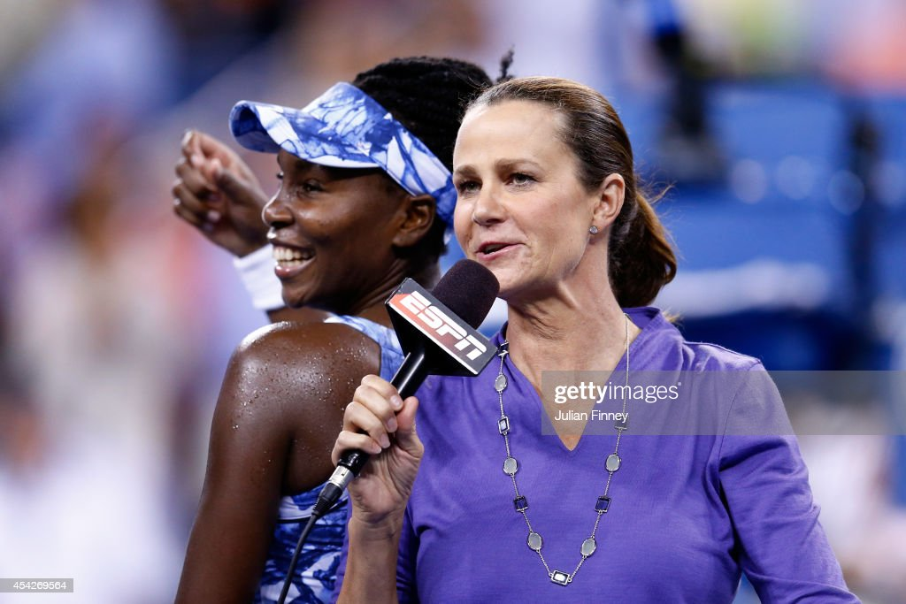 Venus Williams of the United States talks with ESPN tennis broadcaster Pam Shriver after defeating Timea Bacsinszky of Switzerland in their women's...