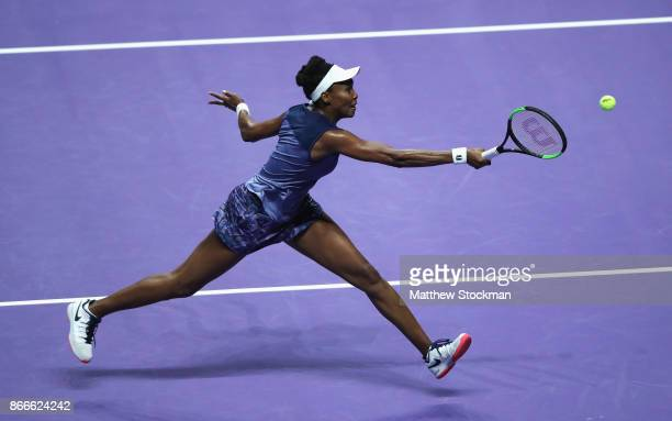 Venus Williams of the United States volleys in her singles match against Garbine Muguruza of Spain during day 5 of the BNP Paribas WTA Finals...