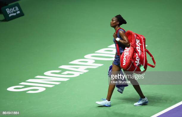 Venus Williams of the United States walks off court after her defeat by Karolina Pliskova of Czech Republic during day 1 of the BNP Paribas WTA...