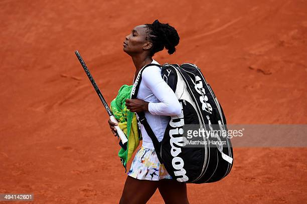 Venus Williams of the United States walks off the court following her defeat in her women's singles match against Anna Schmiedlova of Slovakia on day...