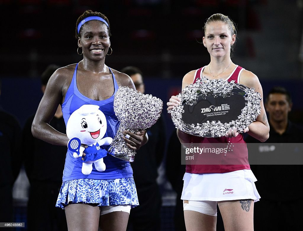 Venus Williams of the US and Karolina Pliskova of the Czech Republic pose with their trophies after their women's singles final match at the WTA...