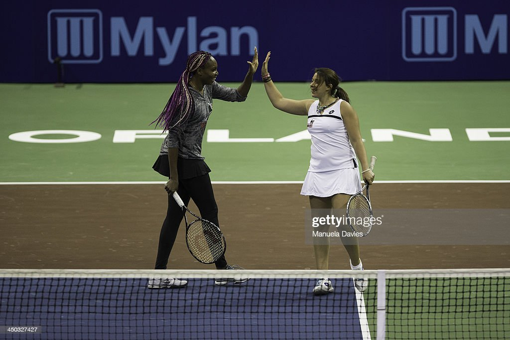 Venus Williams of the U.S. and Marion Bartoli of France react during the exhibition doubles match against Andy Roddick and Elton John during the 2013 Mylan WTT Smash Hits on November 17, 2013 at the ESPN Wide World of Sports Complex in Lake Buena Vista, Florida.