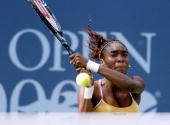 Venus Williams of the US follows through in a backhand stroke during her semifinals match against Martina Hingis of Switzerland 08 September 2000 at...