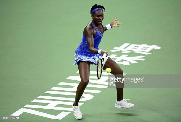 Venus Williams of the US hits a return against Roberta Vinci of Italy during their women's singles semifinal match at the WTA Elite Trophy in Zhuhai...