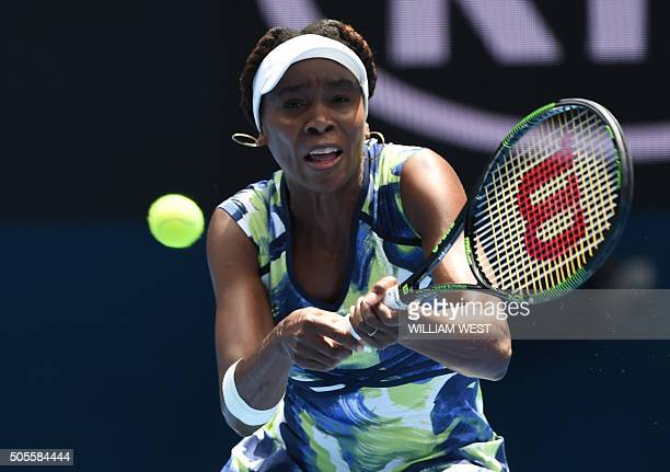 Venus Williams of the US plays a backhand return during her women's singles match against Britain's Johanna Konta on day two of the 2016 Australian...