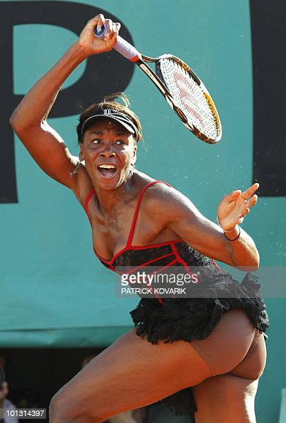 Venus Williams of the US plays a return to Patty Schnyder Switzerland during their Women's first round match in the French Open tennis championship...