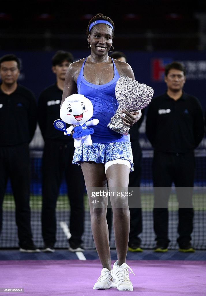 Venus Williams of the US poses with her trophy after winning the women's singles final match against Karolina Pliskova of the Czech Republic at the...