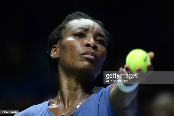 Venus Williams of the US prepares to serve against Karolina Pliskova of the Czech Republic during the WTA Finals tennis tournament in Singapore on...
