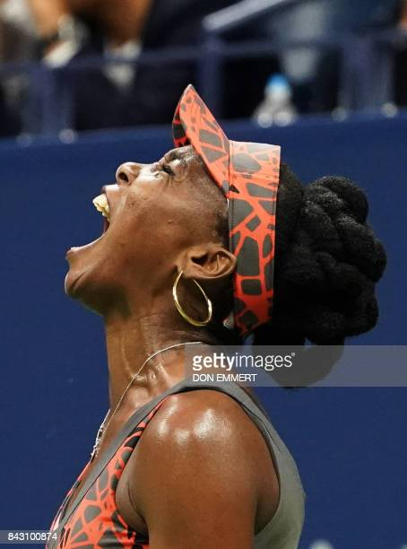 Venus Williams of the US reacts winning a point against Czech Republic's Petra Kvitova during their 2017 US Open Women's Singles Quarterfinal match...