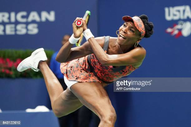 TOPSHOT Venus Williams of the US returns the ball to Czech Republic's Petra Kvitova during their 2017 US Open Women's Singles Quarterfinal match at...