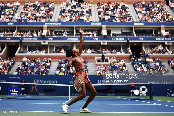 Venus Williams of the US serves the ball Greece's Maria Sakkari during their 2017 US Open Women's Singles match at the USTA Billie Jean King National...