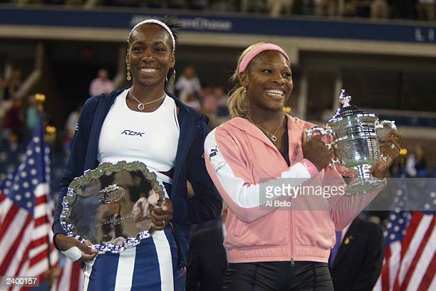 Venus Williams of the USA and Serena Williams of the USA pose for photographers after the women's final of the US Open at the USTA National Tennis...