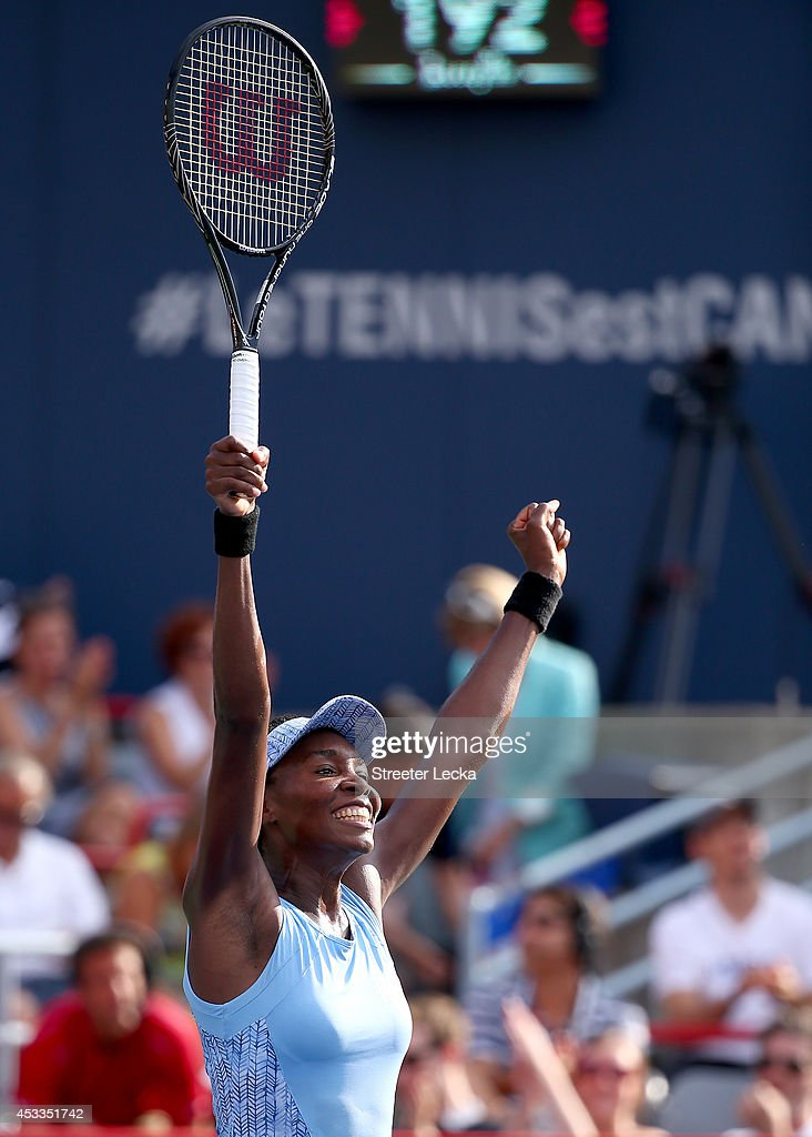Venus Williams of the USA celebrates after defeating Carla Suarez Navarro of Spain in their quarterfinal match during the Rogers Cup at Uniprix...