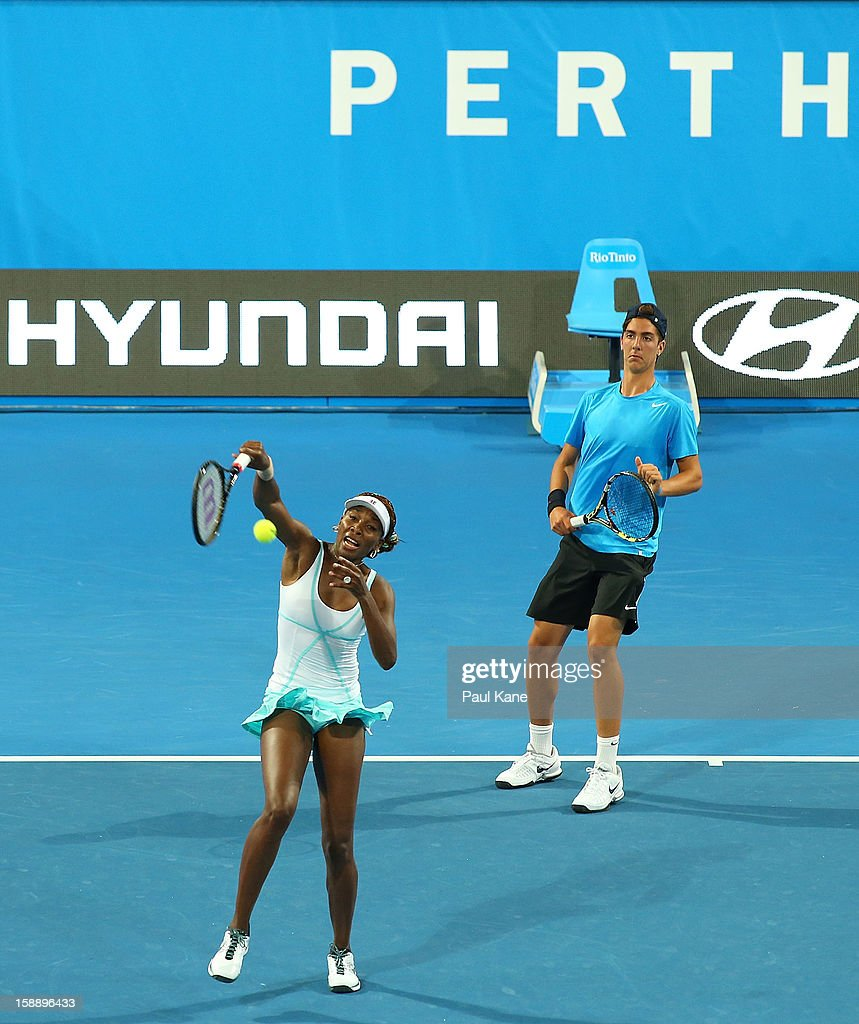 Venus Williams of the USA hits a return shot partnered with Thanasi Kakkinakis of Australia in the mixed doubles match against Anabel Medina Garrigues and Fernando Verdasco of Spain during day six of the Hopman Cup at Perth Arena on January 3, 2013 in Perth, Australia. Thanasi Kakkinakis, the number 2 ranked 16 year old player in the world, replaced John Isner of the USA after withdrawing from the event due to injury.
