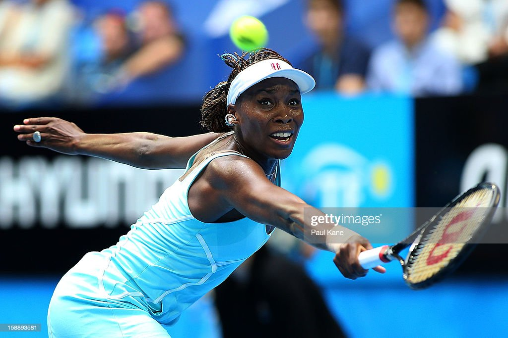 <a gi-track='captionPersonalityLinkClicked' href=/galleries/search?phrase=Venus+Williams&family=editorial&specificpeople=171981 ng-click='$event.stopPropagation()'>Venus Williams</a> of the USA plays a backhand in her match against Anabel Medina Garrigues of Spain during day six of the Hopman Cup at Perth Arena on January 3, 2013 in Perth, Australia.