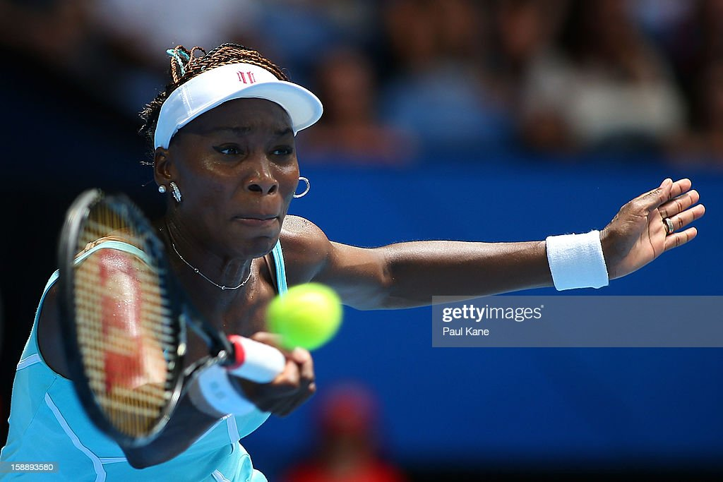 <a gi-track='captionPersonalityLinkClicked' href=/galleries/search?phrase=Venus+Williams&family=editorial&specificpeople=171981 ng-click='$event.stopPropagation()'>Venus Williams</a> of the USA plays a forehand in her match against Anabel Medina Garrigues of Spain during day six of the Hopman Cup at Perth Arena on January 3, 2013 in Perth, Australia.