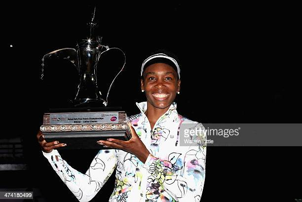 Venus Williams of the USA poses with the trophy after beating Alize Cornet of France in the final of the WTA Dubai Dury Free Tennis Championship at...