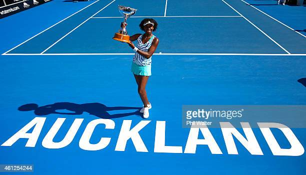 Venus Williams of the USA poses with the trophy following her singles final match against Caroline Wozniacki of Denmark during day six of the 2015...