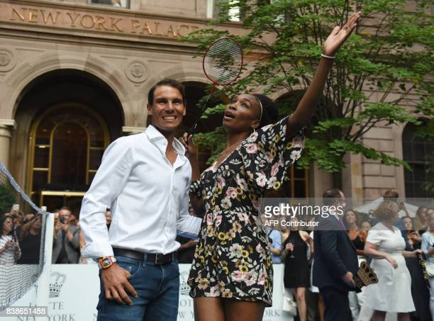 TOPSHOT Venus Williams of the USA poses with world number one tennis player Rafael Nadal of Spain following their match in the Lotte New York Palace...