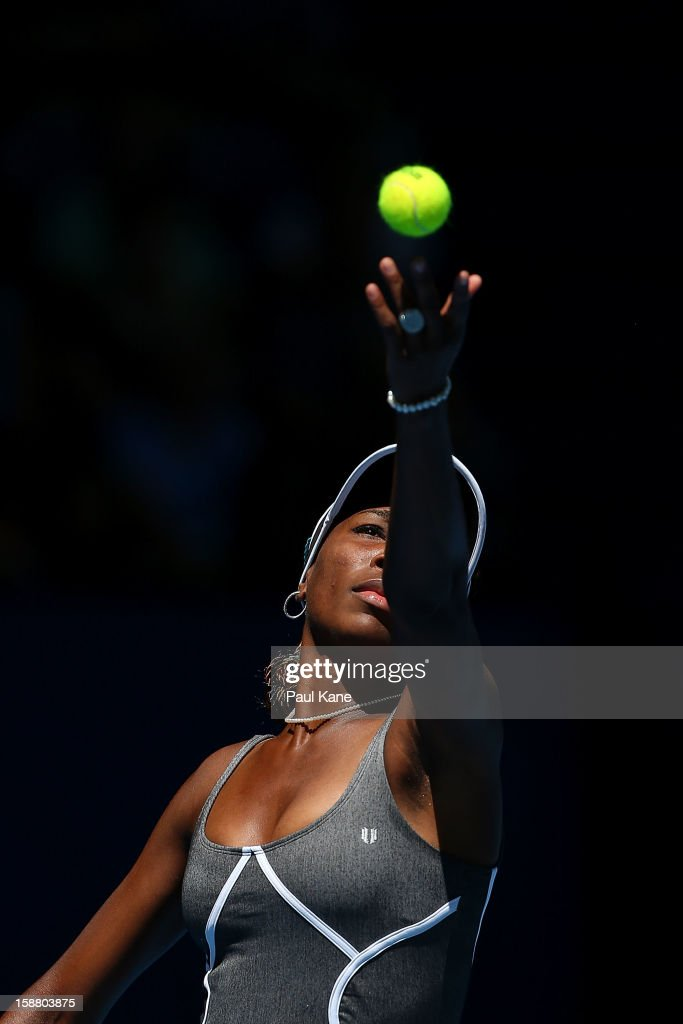<a gi-track='captionPersonalityLinkClicked' href=/galleries/search?phrase=Venus+Williams&family=editorial&specificpeople=171981 ng-click='$event.stopPropagation()'>Venus Williams</a> of the USA serves in her singles match against Chanelle Scheepers of South Africa during day two of the Hopman Cup at Perth Arena on December 30, 2012 in Perth, Australia.