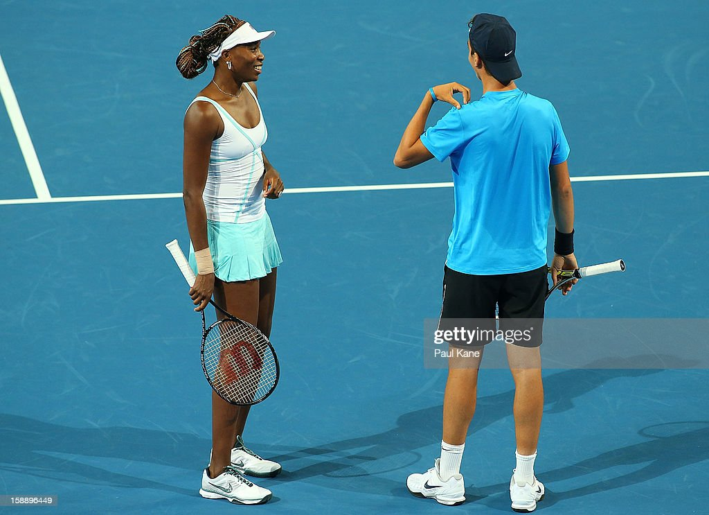 Venus Williams of the USA talks with Thanasi Kakkinakis of Australia in the mixed doubles match against Anabel Medina Garrigues and Fernando Verdasco of Spain during day six of the Hopman Cup at Perth Arena on January 3, 2013 in Perth, Australia. Thanasi Kakkinakis, the number 2 ranked 16 year old player in the world, replaced John Isner of the USA after withdrawing from the event due to injury.