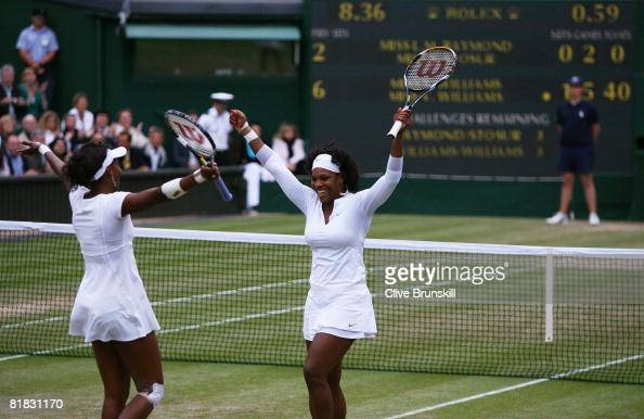 Venus Williams of United States and Serena Williams of United States celebrate match point and winning the women's doubles Final match against Lisa...