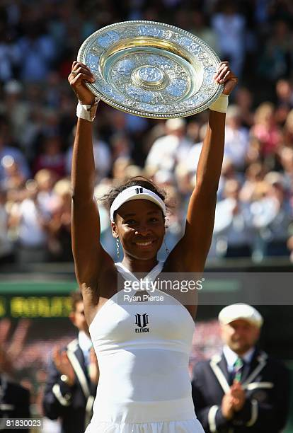 Venus Williams of United States celebrates winning the Championship trophy during the women's singles Final match against Serena Williams of United...
