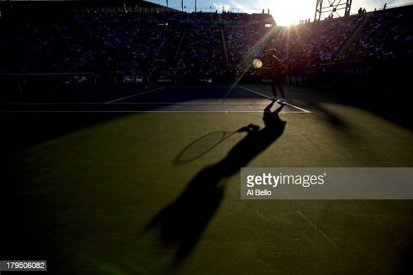 Venus Williams of United States of America in action next to her partner Serena Williams of the United States of America during their women's doubles...