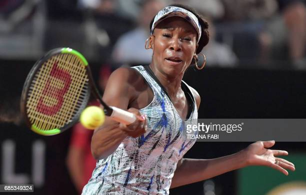 Venus Williams of US returns the ball to Garbine Muguruza of Spain during the WTA Tennis Open tournament in Rome at the Foro Italico on May 19 2017 /...