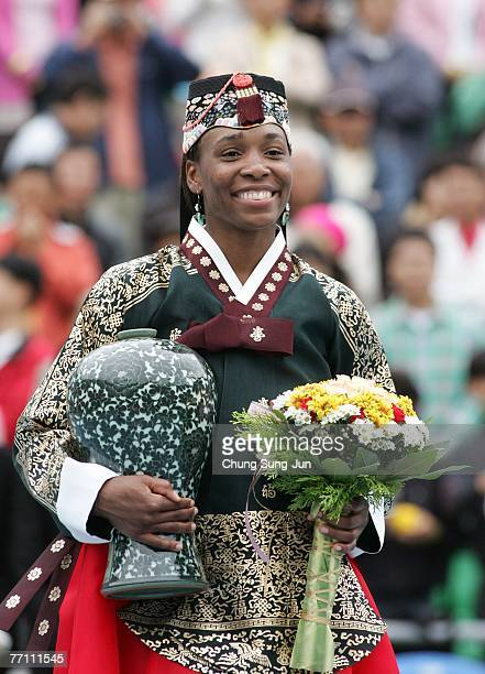 Venus Williams of USA celebrates with the trophy after defeating Maria Kirilenko of Russia by a score of 63 16 64 to win the Women's Singles Final on...