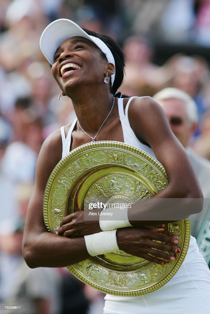 <a gi-track='captionPersonalityLinkClicked' href=/galleries/search?phrase=Venus+Williams&family=editorial&specificpeople=171981 ng-click='$event.stopPropagation()'>Venus Williams</a> of USA hugs the trophy following her victory during the Women's Singles final match against Marion Bartoli of France during day twelve of the Wimbledon Lawn Tennis Championships at the All England Lawn Tennis and Croquet Club on July 7, 2007 in London, England. Williams won 6-4, 6-1.