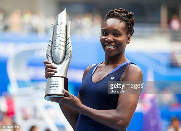 Venus Williams of USA poses with her trophy after winning the women's singles final against Garbine Muguruza of Spain during day 7 of 2015 Dongfeng...