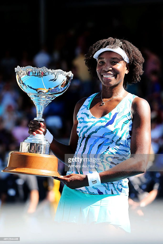 Venus Williams of USA poses with the trophy after winning her singles final match against Caroline Wozniacki of Denmark during day six of the 2015...