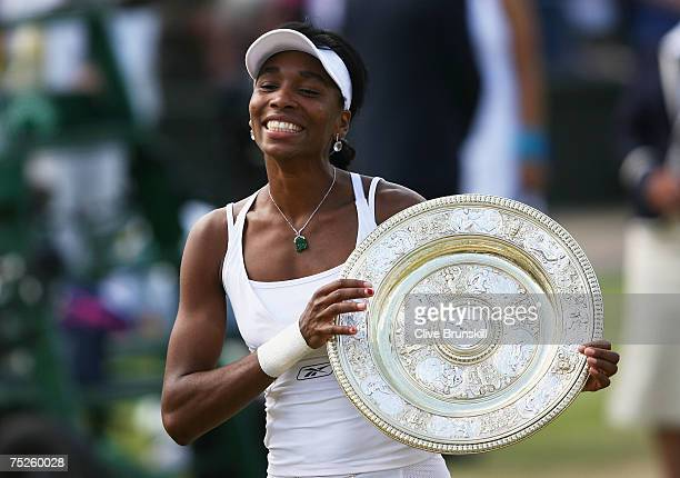 Venus Williams of USA poses with the trophy following her victory during the Women's Singles final match against Marion Bartoli of France during day...