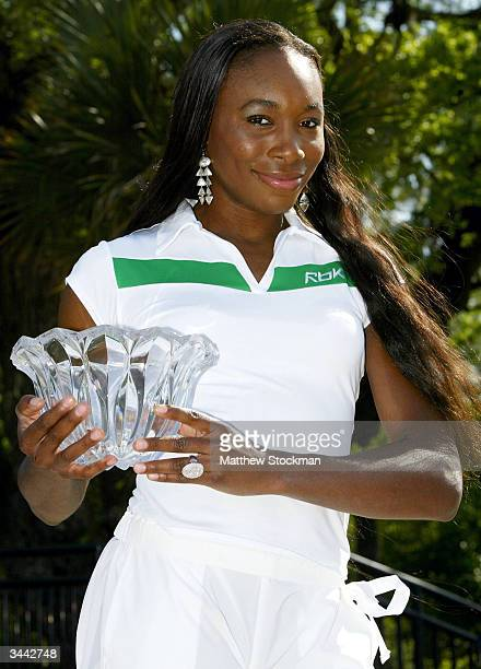Venus Williams poses for photographers after her win over Conchita Martinez of Spain during the finals of the Family Circle Cup April 18 2004 at the...